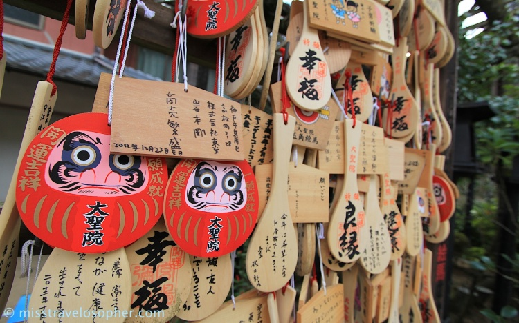 Daruma and wooden rice paddle shaped ema (Daisho-in, Miyajima)