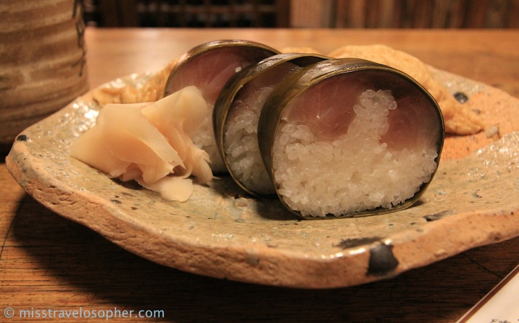 Sabazushi (鯖寿司): a large portion of pickled mackerel fish on top of vinegared sushi rice, and wrapped in konbu (kelp)