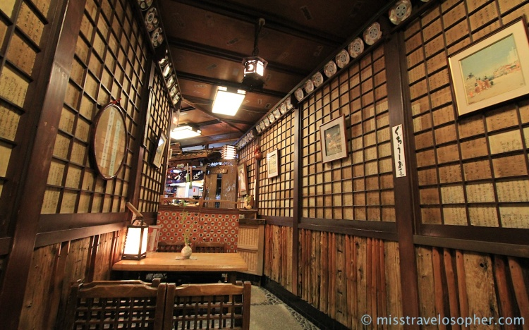 The atmospheric and quaint shop interior of Izuju Sushi