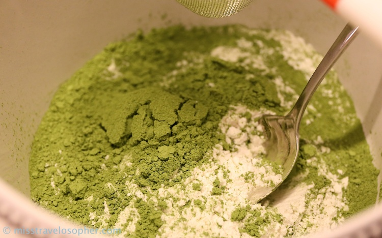Mixing bowl with the dry ingredients (flour, matcha powder and baking powder)