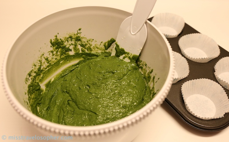 After mixing the wet and dry ingredients, the batter displays a brilliant green color