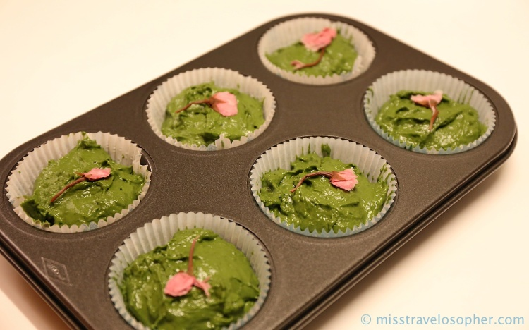 Ta-daa!! Ready to be steamed! Brilliant green batter with a pretty pink sakura flower on top :)
