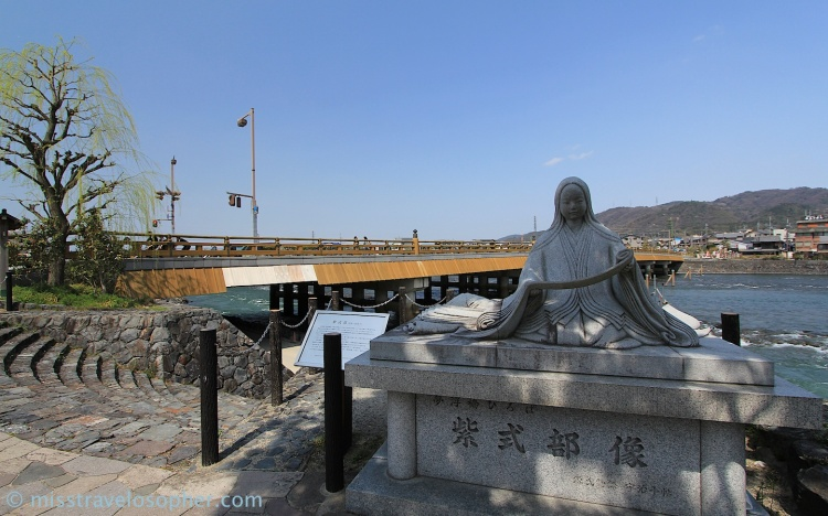 Tale of Genji statue with Uji Bridge in the background