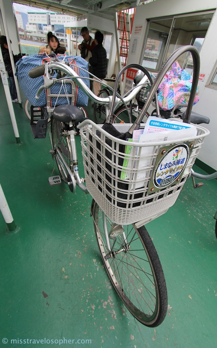 Our bicycles on board the ferry with our road trip luggage sitting snugly in the child seat